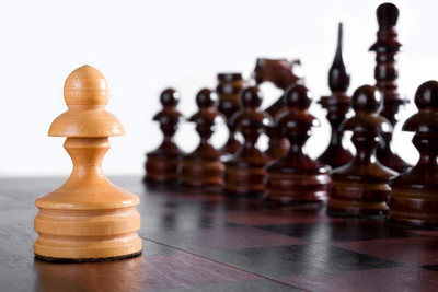 White pawn against black chess pieces formation. Opening gambit